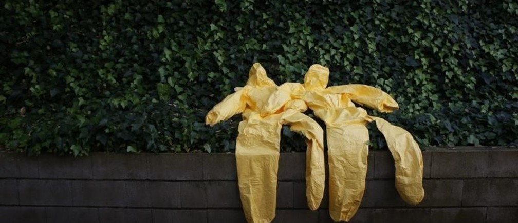 Protective suits are left to dry after an Ebola training session held by Spain's Red Cross in Madrid October 29, 2014. The Spanish Red Cross is training doctors, nurses and engineers to fight Ebola in Western Africa during a two day pre-deployment course at a mock field hospital resembling the Ebola treatment center the organization has in Kenema, Sierra Leone. REUTERS/Susana Vera (SPAIN - Tags: HEALTH SOCIETY) - GM1EAAU0ENS01