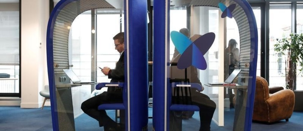 Employees work on computers in silence phone boxes at the French start-up Sigfox offices in Paris, France, February 14, 2018.