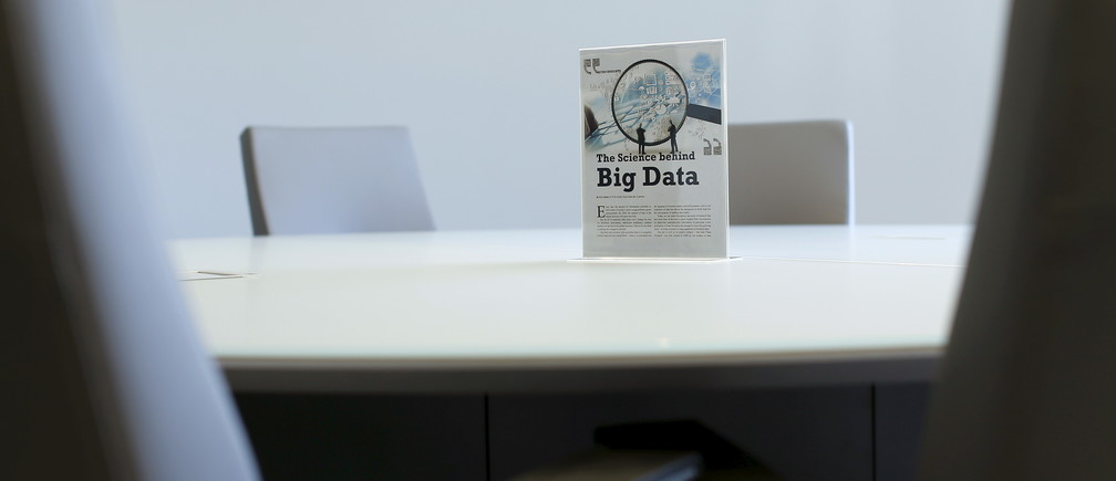 A sign sits on a table in a conference room during the opening of a data lab by information services company Experian in San Diego, California April 12, 2016.