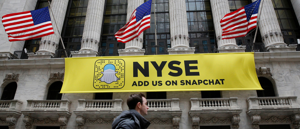 A Snapchat sign hangs on the facade of the New York Stock Exchange (NYSE) in New York City, U.S., January 23, 2017.  REUTERS/Brendan McDermid - RTSX0N2