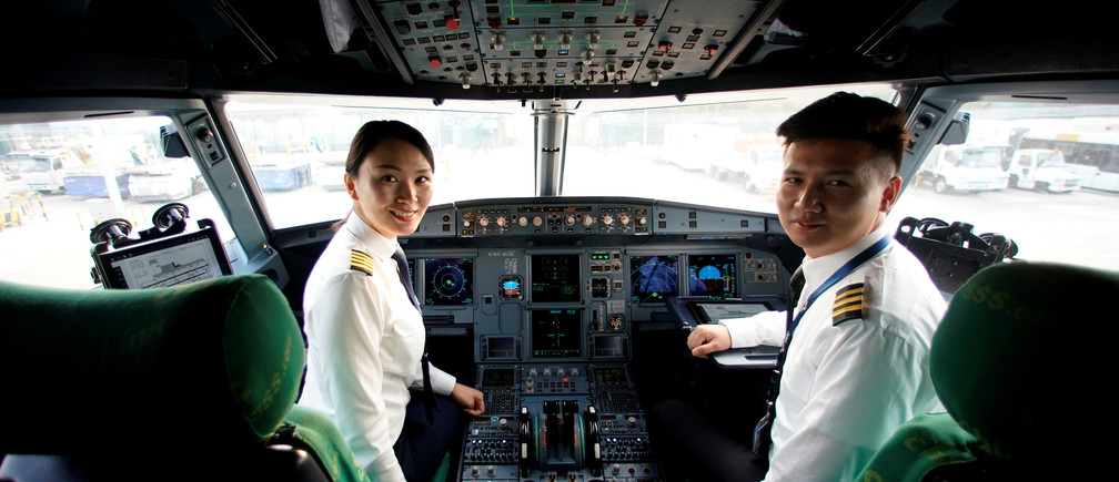 Captain Han Siyuan, 30, poses in the cockpit of Spring Airlines' Airbus A320 before taking off at Hongqiao International Airport in Shanghai, China October 18, 2018. Picture taken October 18, 2018. REUTERS/Aly Song - RC1A0A6AAD90