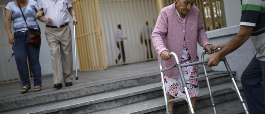 Elderly Venezuelan citizens depart after casting their votes at a polling station during the presidential election in Caracas, Venezuela, May 20, 2018. REUTERS/Carlos Garcia Rawlins