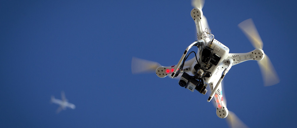 An airplane flies over a drone during the Polar Bear Plunge on Coney Island in the Brooklyn borough of New York January 1, 2015. The Coney Island Polar Bear Club is one of the oldest winter bathing organizations in the United States and holds a New Year's Day plunge every year.     REUTERS/Carlo Allegri   (UNITED STATES - Tags: SOCIETY ANNIVERSARY) - GM1EB120GDH01
