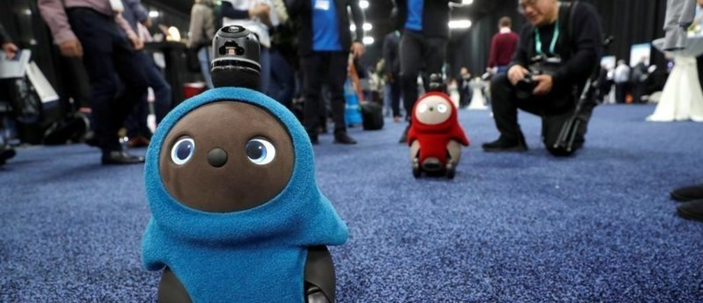 Lovot companion robots by Groove X wander in front their booth at CES Unveiled during the 2020 CES in Las Vegas, Nevada, U.S. January 5, 2020. REUTERS/Steve Marcus - RC27AE9HSTFB