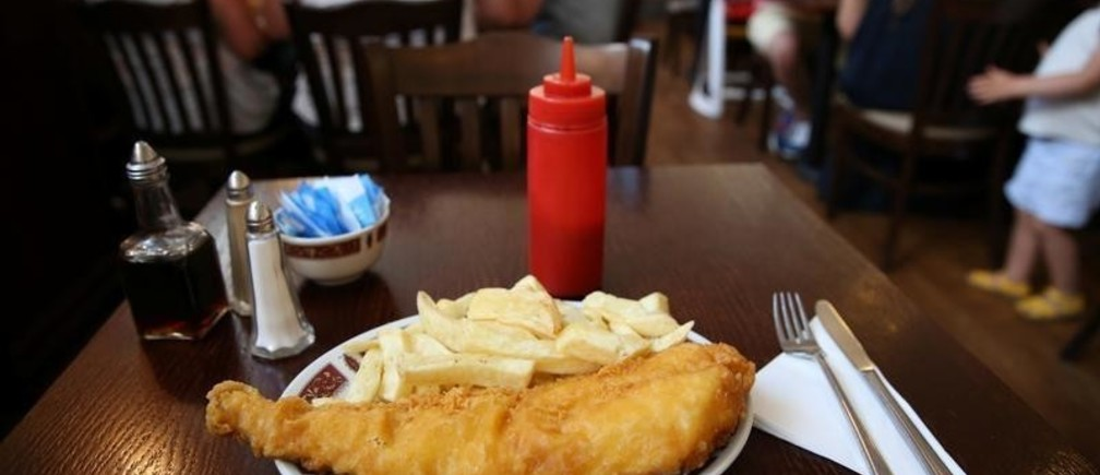 "Fish and chips are seen at a table in Clacton-on-Sea, a town in eastern England, where 70 percent of people voted on June 23, 2016 to leave the European Union, Britain August 22, 2016. REUTERS/Neil Hall        SEARCH ""CLACTON BREXIT"" FOR THIS STORY. SEARCH ""WIDER IMAGE"" FOR ALL STORIES.  - S1AETYPCFPAB"