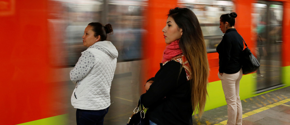 Women wait to board female-only carriages on the Mexico City underground.