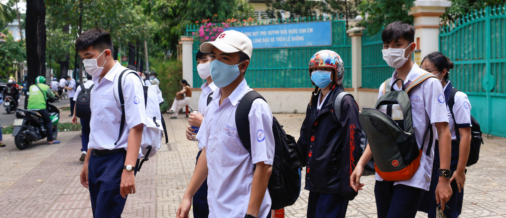High school students leave after their first day of classes, as the government eased the nationwide lockdown during the coronavirus disease (COVID-19) outbreak in Ho Chi Minh, Vietnam May 5, 2020.