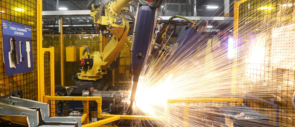Robot welders on the floor of Alfield Industries, a subsidiary of Martinrea, one of three global auto parts makers in Canada, in Vaughan, Ontario, Canada April 28, 2017. Picture taken April 28, 2017. REUTERS/Fred Thornhill - RC16FA2A52E0