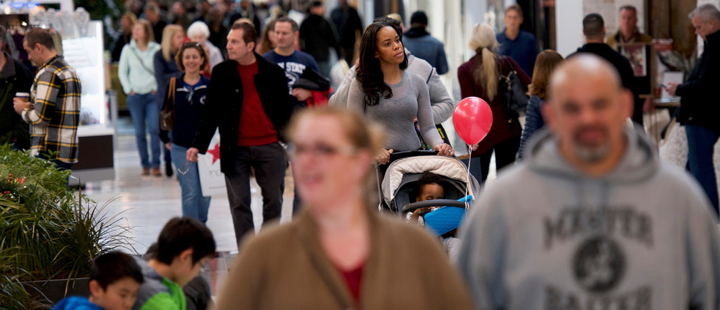 Shoppers walk through the King of Prussia Mall, United States' largest retail shopping space, in King of Prussia, Pennsylvania, U.S., December 8, 2018.  REUTERS/Mark Makela - RC154E642930