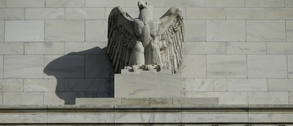 A detail from the front of the United States Federal Reserve Board building is shown in Washington October 28, 2014. The U.S. Federal Reserve this week will likely reinforce its stated willingness to wait a long while before hiking interest rates after a volatile month in financial markets that saw some measure of inflation expectations drop worryingly low.
