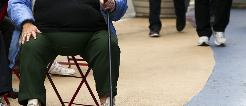 An overweight woman sits on a chair in Times Square in New York, May 8, 2012.