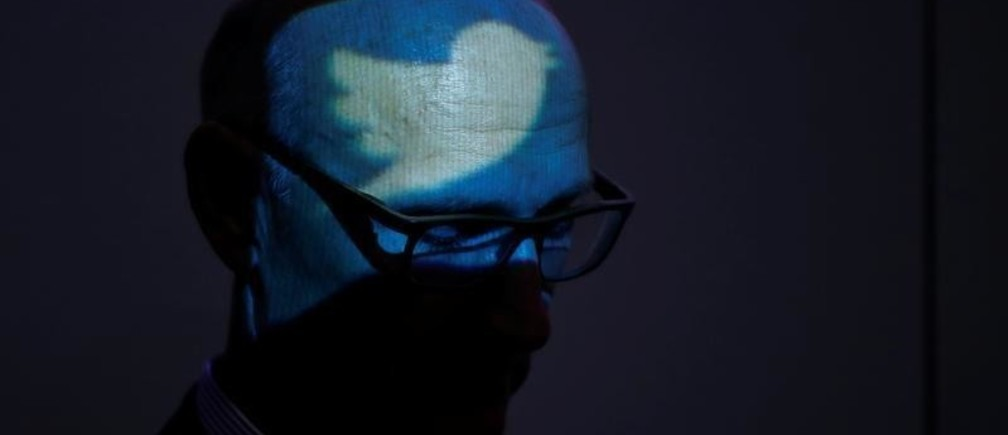 The logo of Twitter is projected to the head of Timotheus Hoettges, Chief Executive Officer of Germany's telecommunications giant Deutsche Telekom AG during the opening ceremony for the new Cyber Defense and Security Operation Center (SOC) of Telekom Security in Bonn October 26, 2017.