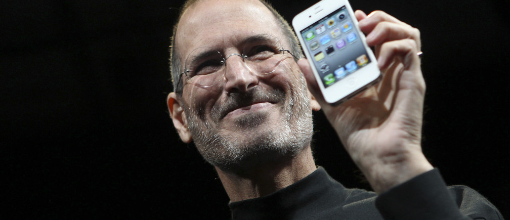 Apple CEO Steve Jobs poses with the new iPhone 4 during the Apple Worldwide Developers Conference in San Francisco, California June 7, 2010