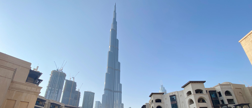 A general view shows the area outside the Burj Khalifa, the world's tallest building, mostly deserted, after a curfew was imposed to prevent the spread of the coronavirus disease (COVID-19), in Dubai, United Arab Emirates March 25, 2020. Picture taken March 25, 2020. REUTERS/Tarek Fahmy - RC2CSF922LDR