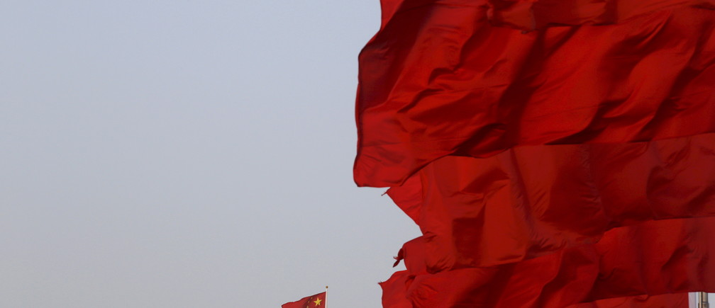 Chinese national flags flutter at Tiananmen Square ahead of the opening session of the National People's Congress (NPC) in Beijing, China, March 5, 2016. REUTERS/Kim Kyung-hoon/File Photo - RTX2B45C