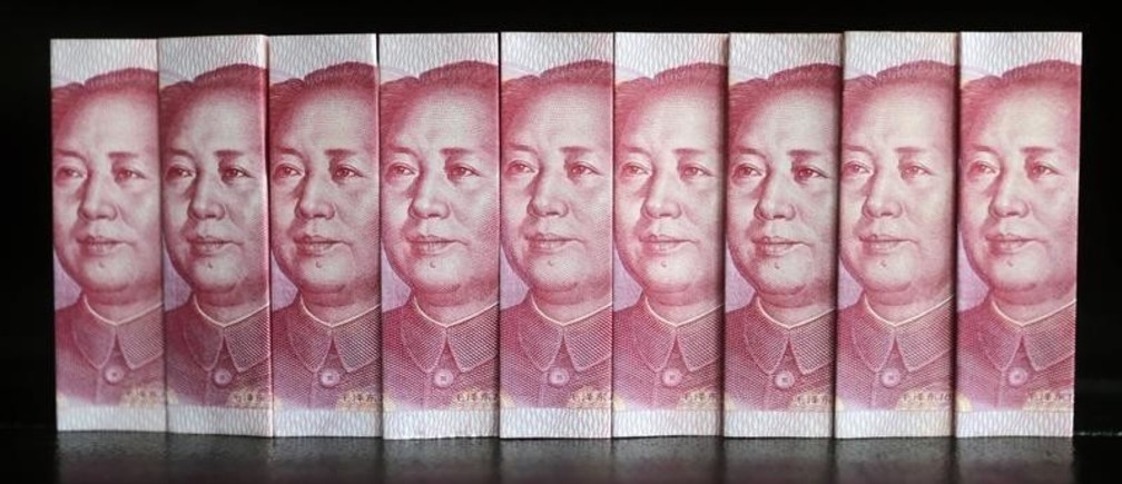 Chinese 100 yuan banknotes are seen in this picture illustration taken in Beijing July 11, 2013. China's central bank has standardised rules on cross-border yuan transactions for domestic banks and companies, the latest step to boost the yuan's global influence. REUTERS/Jason Lee (CHINA - Tags: BUSINESS TPX IMAGES OF THE DAY) - RTX11JFZ