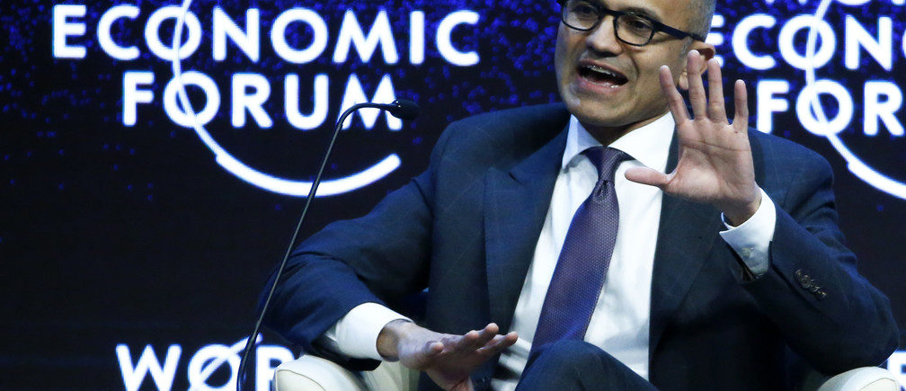 """Satya Nadella, CEO of Microsoft Corporation, gestures during the session """"The Future of the Digital Economy"""" in the Swiss mountain resort of Davos January 22, 2015. More than 1,500 business leaders and 40 heads of state or government attend the Jan. 21-24 meeting of the World Economic Forum (WEF) to network and discuss big themes, from the price of oil to the future of the Internet. This year they are meeting in the midst of upheaval, with security forces on heightened alert after attacks in Paris, the European Central Bank considering a radical government bond-buying programme and the safe-haven Swiss franc rocketing.                                                 REUTERS/Ruben Sprich (SWITZERLAND  - Tags: BUSINESS POLITICS)   - LR2EB1M1BZIMH"""