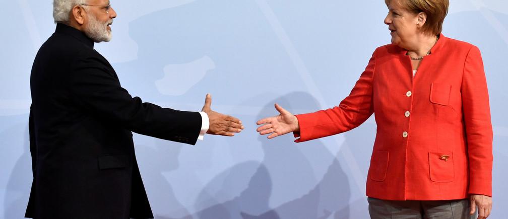 German Chancellor Angela Merkel greets India's Prime Minister Narendra Modi at the beginning of the G20 summit in Hamburg, Germany, July 7, 2017. REUTERS/John MACDOUGALL,POOL - RC11458BD710