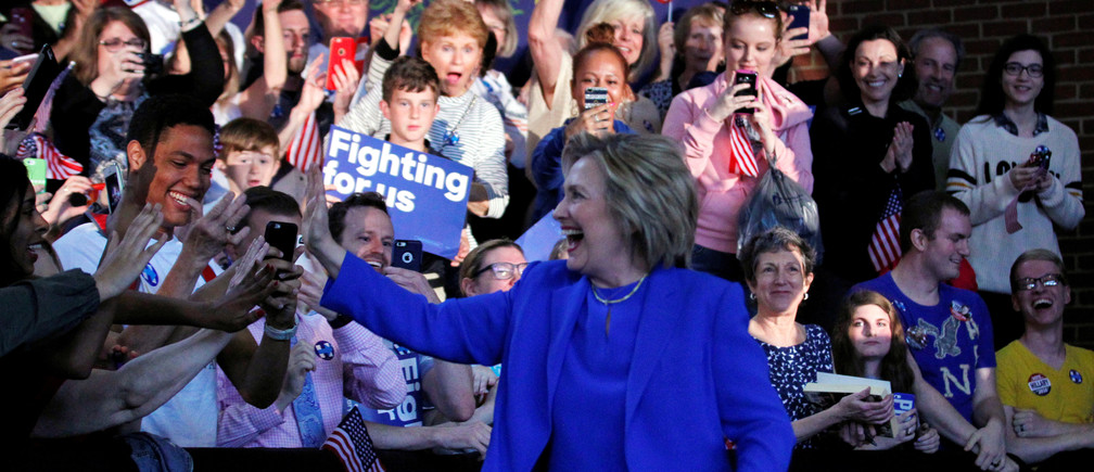 U.S. Democratic presidential candidate Hillary Clinton waves to her supporters before her speech during a rally at Louisville Slugger Field's Hall of Fame Pavilion in Louisville, Kentucky
