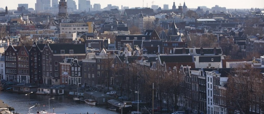 A rootop view of Amsterdam from SkyLounge on the 11th floor of the DoubleTree by Hilton Hotel in Amsterdam April 2, 2013. The Royal celebrations in the Netherlands this week put the country and the capital Amsterdam on front pages and television screens around the world with an orange splash. There's plenty to see and do in 48 hours in this compact city, where the world-famous Rijksmuseum only recently reopened after an extensive renovation.
