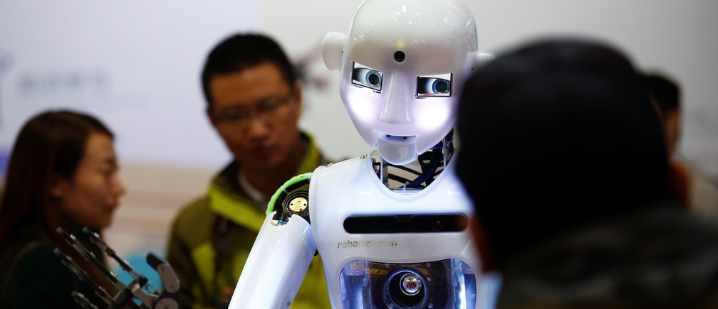 People look at a RoboThespian humanoid robot at the Tami Intelligence Technology stall at the WRC 2016 World Robot Conference in Beijing, China, October 21, 2016.