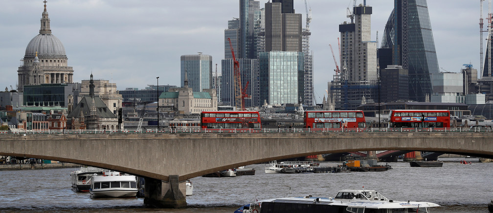 Buildings in the City of London are seen behind Waterloo Bridge in London, Britain October 20, 2017. Picture taken October 20, 2017. REUTERS/Peter Nicholls - RC1333D2BB10
