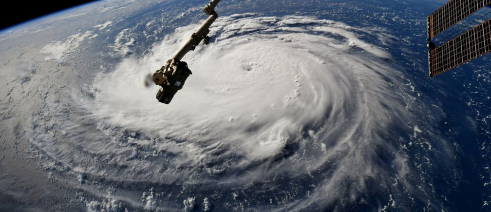 Hurricane Florence is seen from the International Space Station as it churns in the Atlantic Ocean towards the East Coast of the United States, September 10, 2018.  NASA/Handout via REUTERS