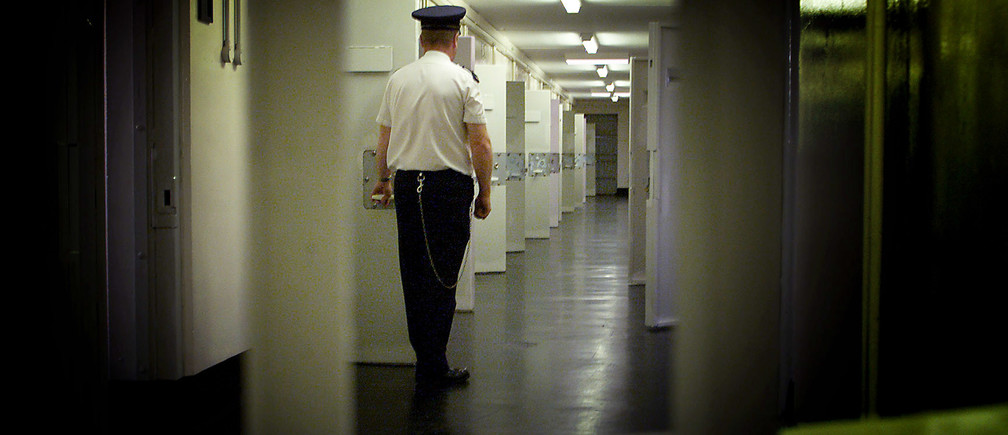 Northern Ireland's notorious Maze prison stands vacant, September 30,2000, after the last remaining guerrilla prisioners were transfered to other jails as part of a peace pact aimed at ending 30 years of political and religious strife. A prison guard is seen in this file photo taken July 25, 2000 as he patrols a corridor in H-Block 7 that once housed Irish Republican inmates.PM/PS/FMS - RP2DRIAOHGAB
