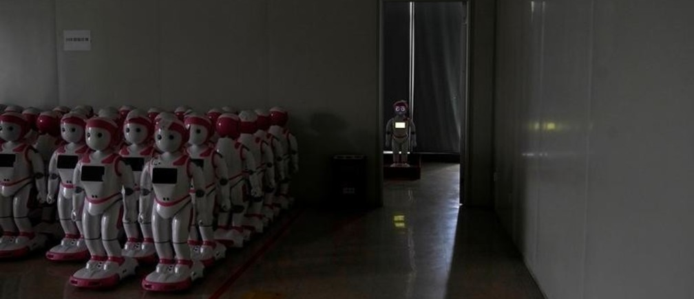 iPal social robots, designed by AvatarMind, are seen at an assembly plant in Suzhou, Jiangsu province, China July 4, 2018. Designed to offer education, care and companionship to children and the elderly, the 3.5-feet tall humanoid robots come in two genders and can tell stories, take photos and deliver educational or promotional content. Picture taken July 4, 2018. REUTERS/Aly Song     TPX IMAGES OF THE DAY - RC137DE78470