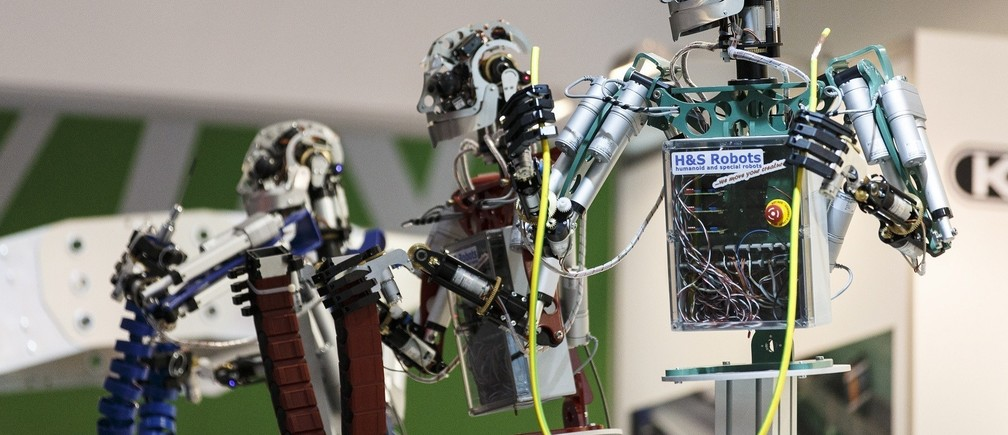 "Robots are seen at the ""Hannover Messe"" industrial trade fair in Hanover April 7, 2014. The world's leading fair for industrial technology, with about 5,000 exhibitors from 65 nations, runs till April 11 with the Netherlands as this year's partner country. REUTERS/Morris Mac Matzen (GERMANY - Tags: SOCIETY BUSINESS)"