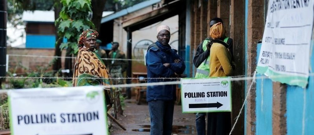 People queue to cast their vote at a polling station during a presidential election re-run in Nairobi, Kenya October 26, 2017. REUTERS/Thomas Mukoya - RC15CD929C00