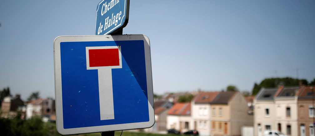A canal towpath with a dead end road sign is seen in the northern city of Amiens, France, June 14, 2017. Picture taken June 14, 2017.   REUTERS/Benoit Tessier - RC1A6ECD5200
