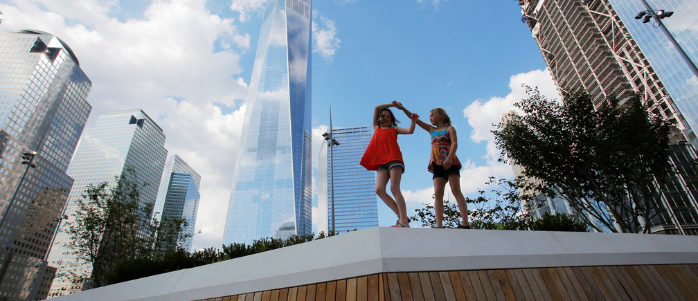 Bella Truman, 9 and Zina DeVoe, 9, both of Manhattan play in the newly opened Liberty Park above Liberty Street on the World Trade Center site in the Manhattan borough of New York, U.S., June 29, 2016.