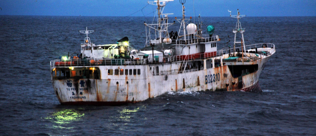 Yu Feng, a Taiwanese-flagged fishing vessel suspected of illegal fishing activity, moves through the water before being boarded by crewmembers from U.S. Coast Guard Cutter Legare and representatives from Sierra Leone's Armed Forces Maritime Wing, Fisheries ministry and Office of National Security, Aug. 17 2009. Legare, homeported in Portsmouth, Va., is currently on a three-month deployment as part of Africa Partnership Station. APS is an international maritime safety and security initiative led by Commander, U.S. Naval Forces Europe-Africa/Commander, U.S. 6th Fleet.