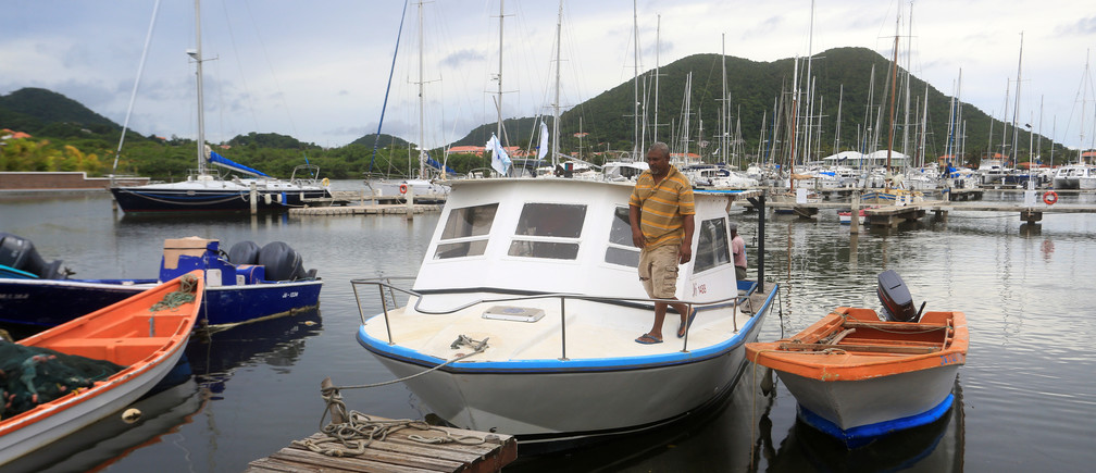 Fisherman Desmond Popo checks his boat in the aftermath of Tropical Storm Dorian at Rodney Bay in St. Lucia, August 27, 2019. REUTERS/Andrea de Silva - RC17A6CC1290