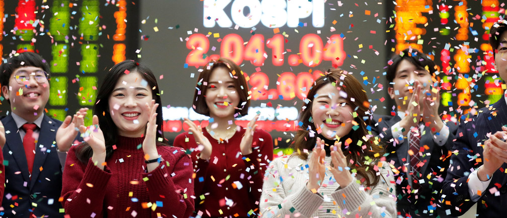 Employees of the Korea Exchange (KRX) pose in front of the final stock price index during a photo opportunity for the media at the ceremonial closing event of the 2018 stock market in Seoul, South Korea, December 28, 2018.    REUTERS/Kim Hong-Ji - RC1A2FFB5DF0