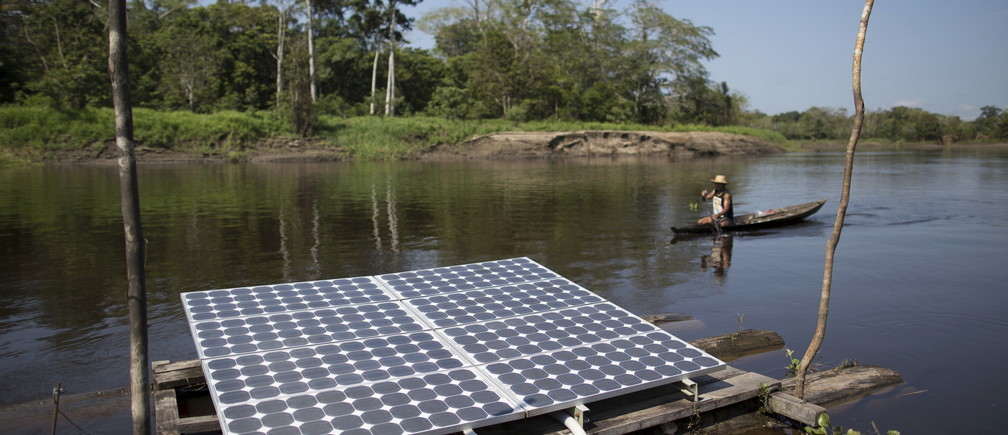 Solar panels power water pumps to supply river water to the houses of the Vila Nova do Amana community in the Sustainable Development Reserve, in Amazonas state, Brazil, September 22, 2015.