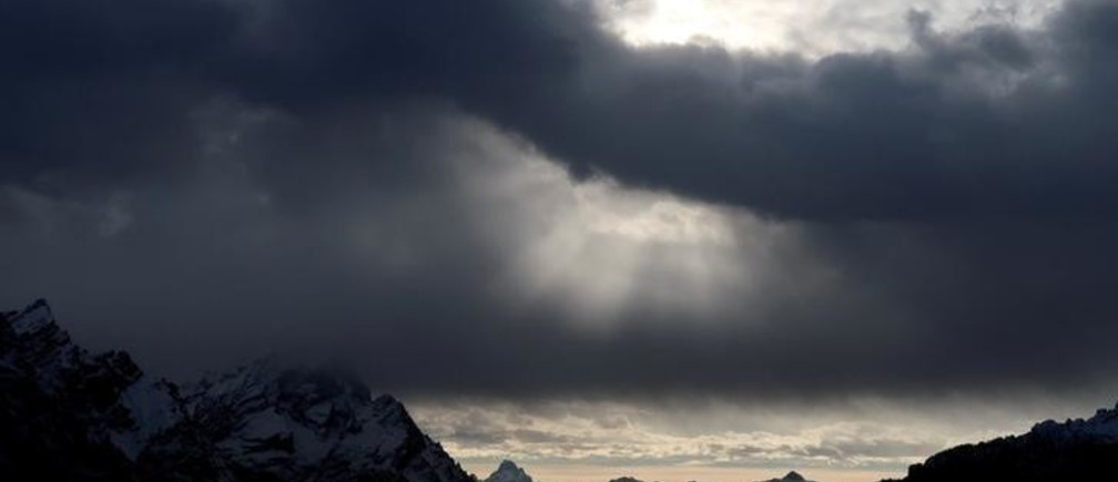 Clouds are seen over the Dolomite mountains around Cortina d'Ampezzo, Italy, January 19, 2018. REUTERS/Stefano Rellandini     TPX IMAGES OF THE DAY