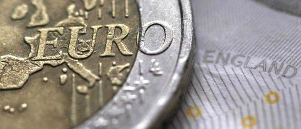 A two Euro coin is pictured next to an English ten Pound note in an illustration taken March 16, 2016.  REUTERS/Phil Noble/Illustration - RTS12V91