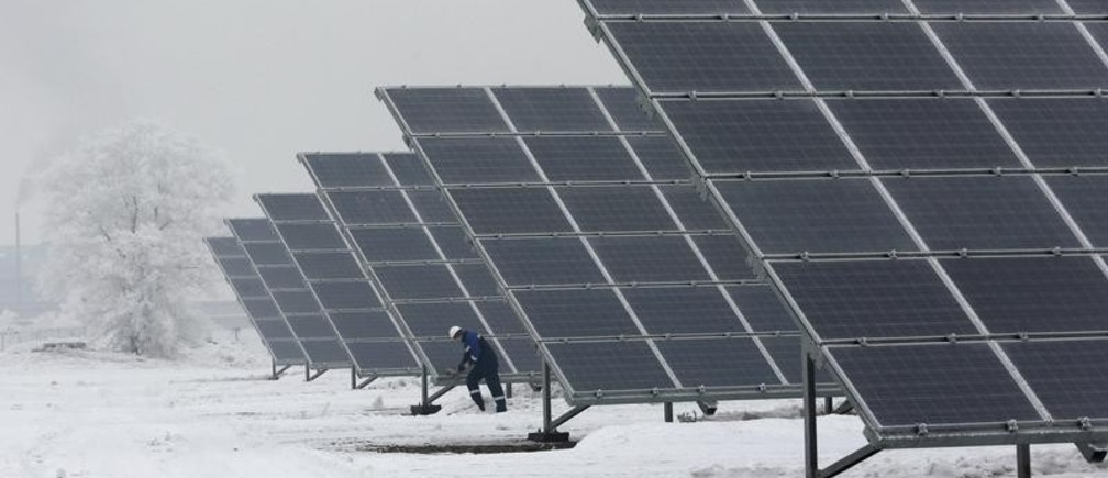 Dmitry Baikalov, a duty engineer, inspects equipment at the Abakan solar electric station in a suburb of the Siberian town of Abakan, Khakassia Republic, Russia, December 17, 2015. Owned by EuroSibenergo company of the En+ Group, the solar electric plant in Siberia with a generating capacity of 5.2 megawatt (MW) will be in operation on December 21, according to the official representative of the company. Picture taken December 17, 2015.