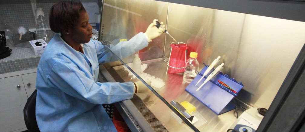Dr. Fatou Soro Ouattara of the Association of Women Researchers in the Ivory Coast (AFEMC-CI) works in her laboratory at the Institut Pasteur in Abidjan March 5, 2013.