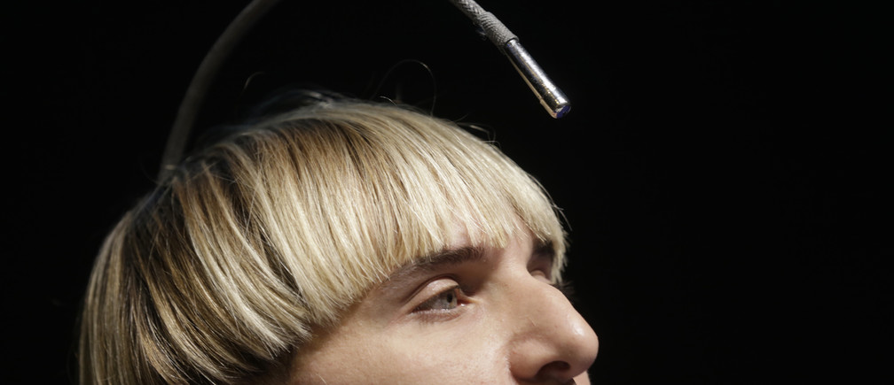 Artist Neil Harbisson, who has an antenna permanently attached to his skull, speaks during the Riga Comm 2014 innovation conference in Riga November 14, 2014. The two-day information and communication technology exhibition and conference began on Friday. REUTERS/Ints Kalnins (LATVIA - Tags: SOCIETY SCIENCE TECHNOLOGY BUSINESS TELECOMS TPX IMAGES OF THE DAY) - RTR4E6TM