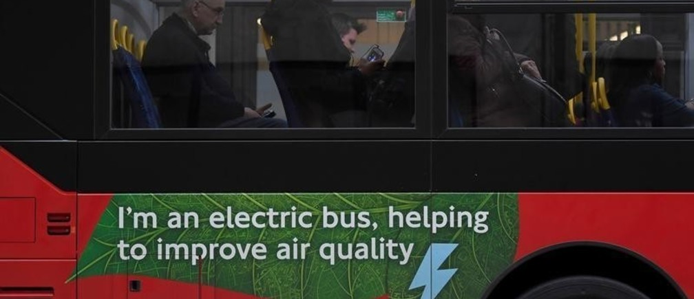 Passengers sit on an electric public bus on the day that Mayor of London Sadiq Khan outlined plans to place a levy on the most polluting vehicles in London, Britain, April 4, 2017.  REUTERS/Toby Melville - RC1BBDE059E0