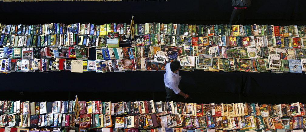People browse books at a book stall in Petaling Jaya, outside Kuala Lumpur October 16, 2013. REUTERS/Samsul Said (MALAYSIA - Tags: SOCIETY BUSINESS MEDIA TPX IMAGES OF THE DAY) - GM1E9AG16J601
