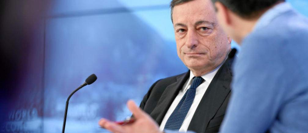 Mario Draghi (L), President, European Central Bank, Frankfurt is interviewed by Lionel Barber (R), Editor, Financial Times, United Kingdom, captured at the Annual Meeting 2016 of the World Economic Forum in Davos, Switzerland, January 22, 2016.