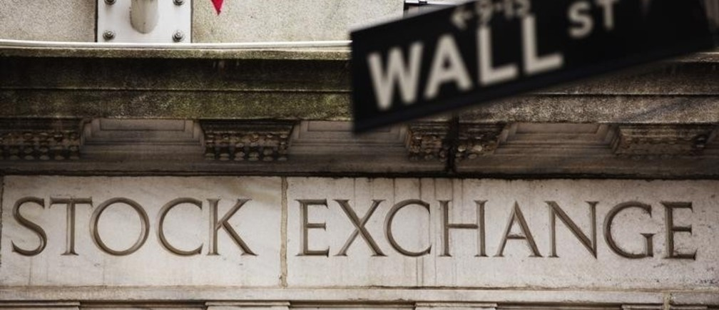 A street sign for Wall Street hangs in front of the New York Stock Exchange May 8, 2013. Stocks pushed further into record territory on Wednesday, driving the S&P 500 to an all-time high close for a fifth day, helped by strength in financials and technology. REUTERS/Lucas Jackson (UNITED STATES - Tags: BUSINESS) - RTXZFHC
