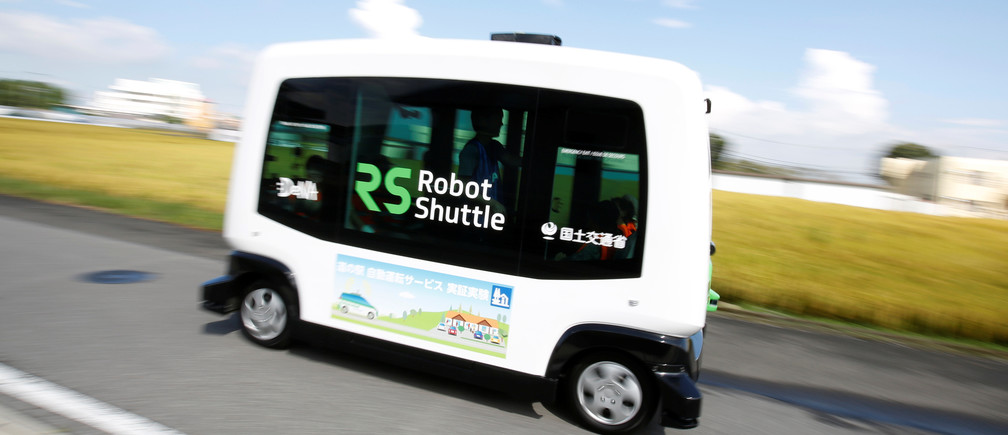 Robot Shuttle, a driver-less, self driving bus, using software developed by Japan's internet commerce and mobile games provider DeNA Co., drives past during an experimental trial with a self-driving bus in a community in Nishikata town, Tochigi Prefecture, Japan September 8, 2017.