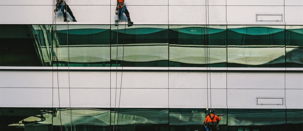 workers washing the windows of an office block
