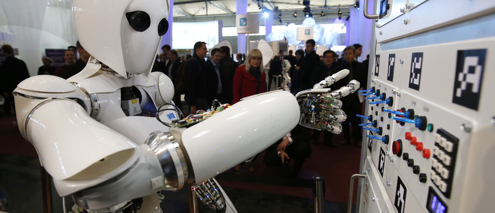 The humanoid robot AILA (artificial intelligence lightweight android) operates a switchboard during a demonstration by the German research centre for artificial intelligence at the CeBit computer fair in Hanover March, 5, 2013. The biggest fair of its kind open its doors to the public on March 5 and will run till March 9, 2013.  REUTERS/Fabrizio Bensch (GERMANY - Tags: BUSINESS SCIENCE TECHNOLOGY) - RTR3ELOF