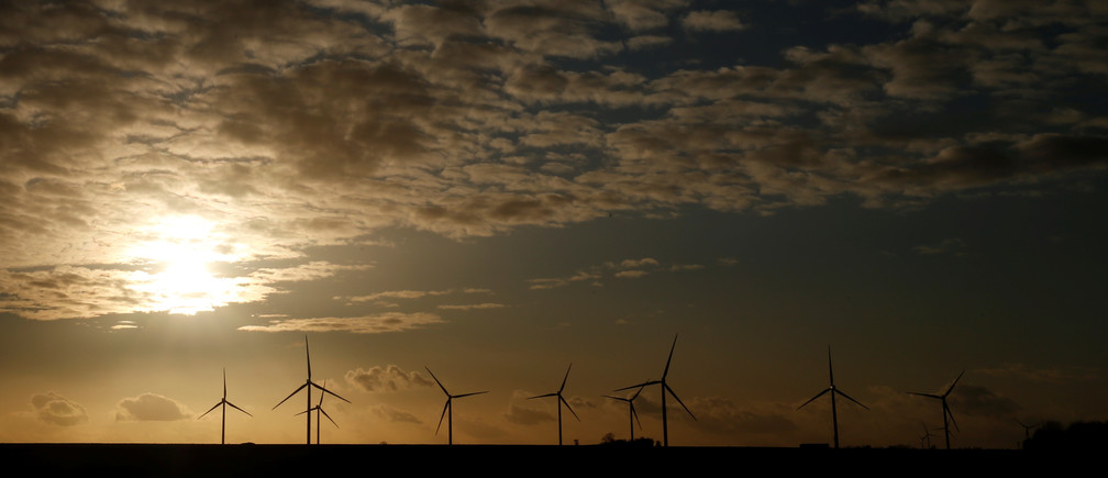 Power-generating windmill turbines are seen at a wind park in Flesquieres near Cambrai, France March 3, 2020. REUTERS/Pascal Rossignol - RC2JCF9MLIJJ